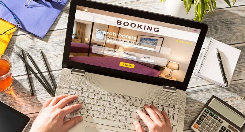 An event planner booking a hotel reservation for an event